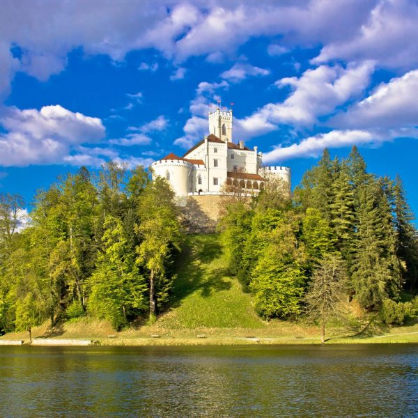 bigstock-Odyllic-Lake-Hill-Castle-Of-Tr-79662070